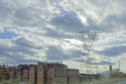 Lumber Yard & Phone Lines Under the Big Sky