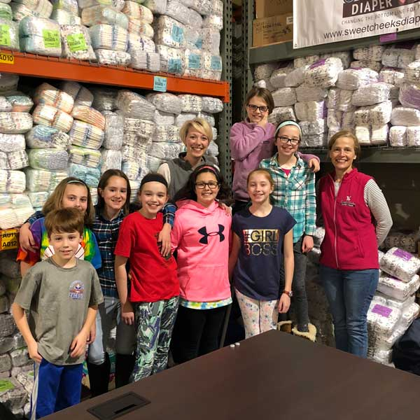 Volunteer at Sweet Cheeks Diaper Bank or donate diapers in Cincinnati.
