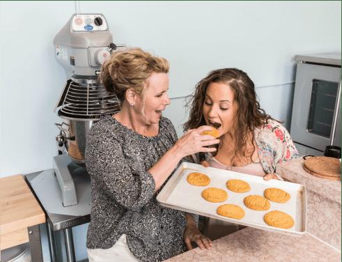 Sharon feeding Kristen a cookie