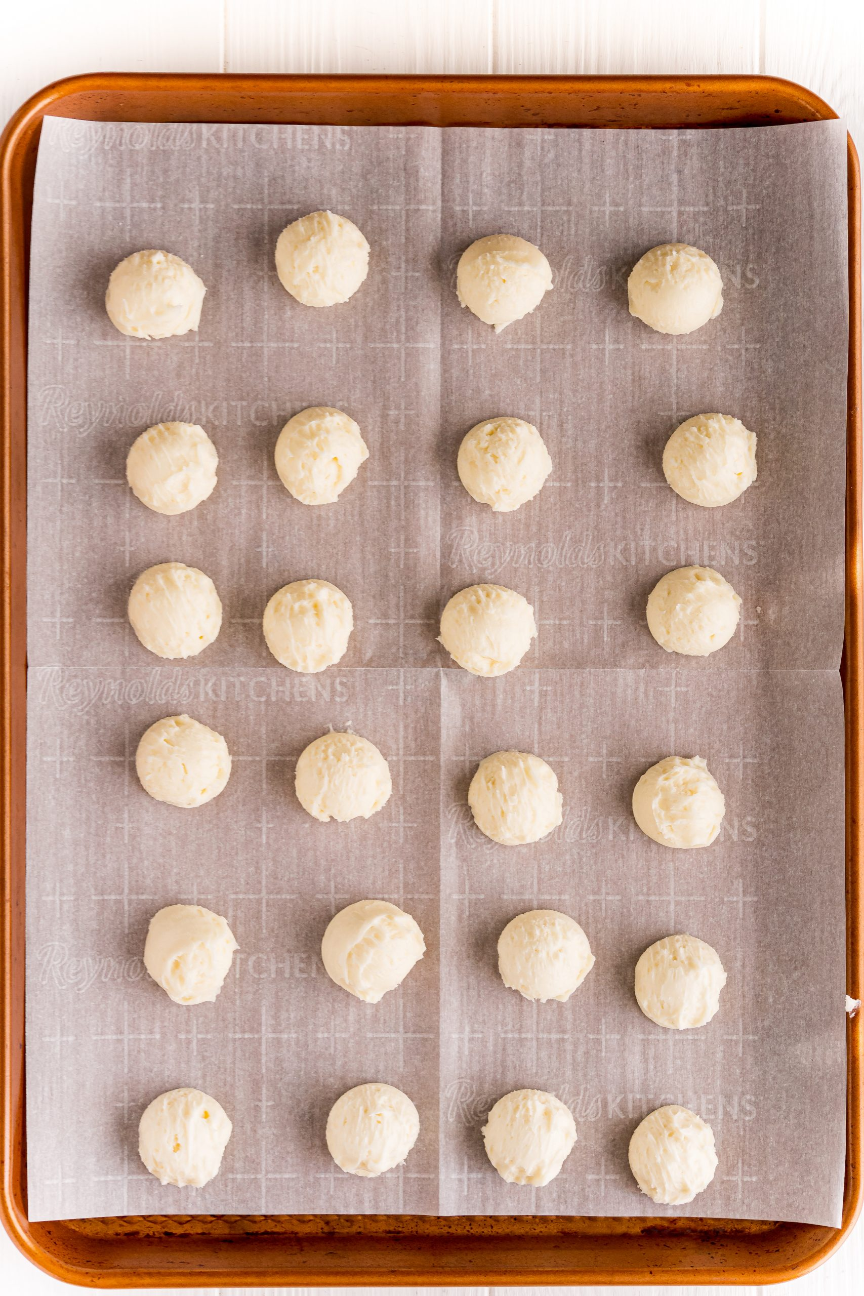 rolled out buttercream candies on a baking sheet