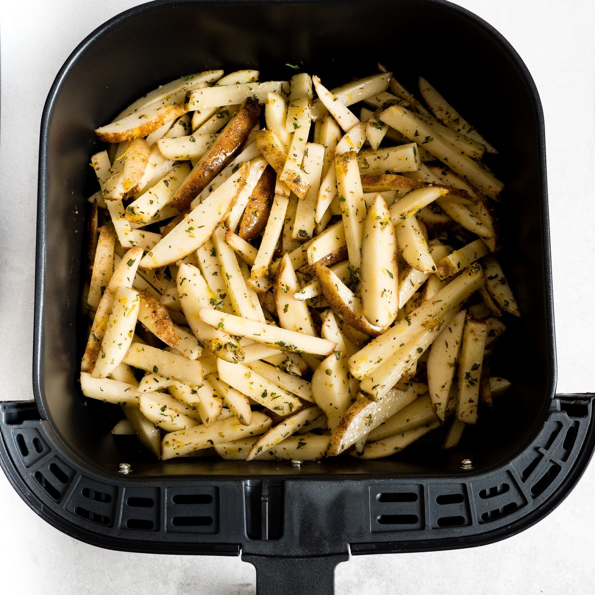 picture of french fries in air fryer basket