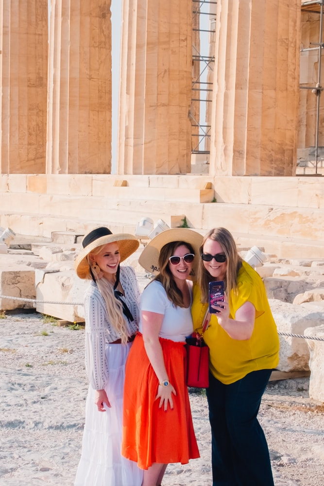 picture of three women taking a selfie in front of the Parthenon, Athens Greece