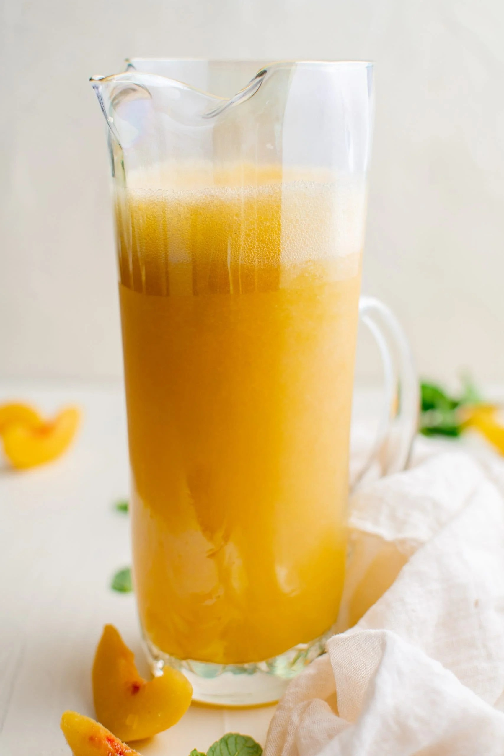picture of peach bellinis in a pitcher