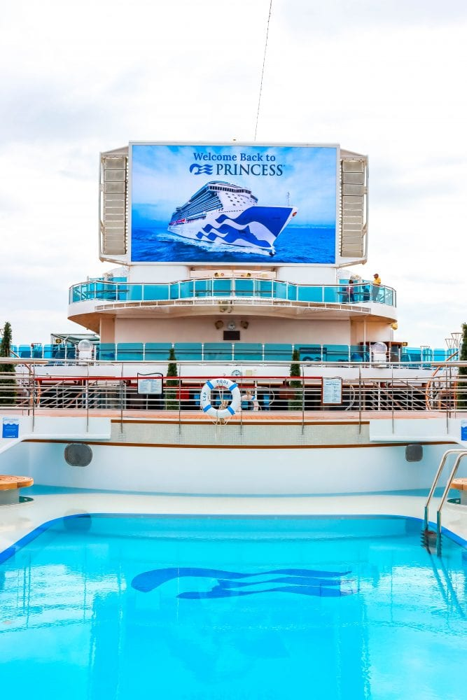 picture of majestic princess tv screen saying welcome back princess above a pool