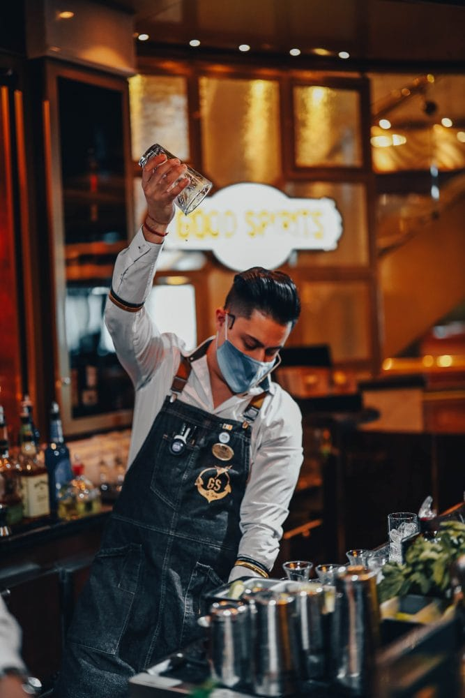 picture of a bartender at Good Spirits bar on Majestic Princess cruise ship in a face mask