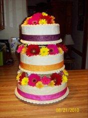 This wedding cake has three different flavors; spice, vanilla & chocolate.