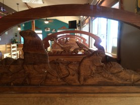 Wood carved seat backs in Mutiny is Brewing, Joseph, OR are all different.