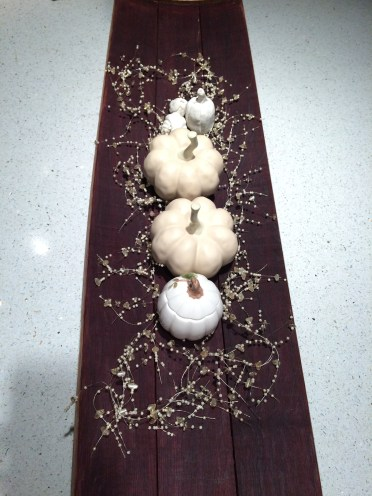 white pumpkins on barrel stave board