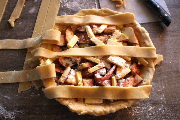 Pulling strips back to make lattice apple pie