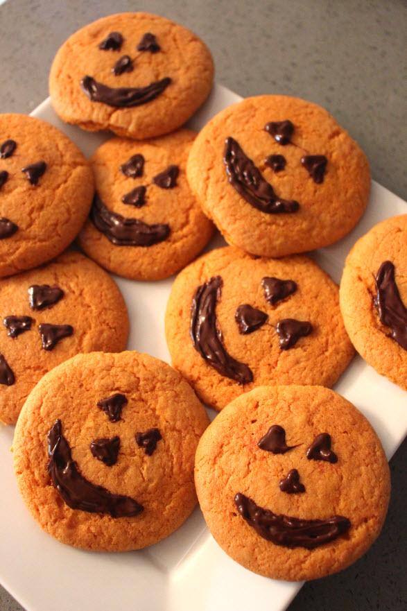 bake pumpkin face cookies for Halloween