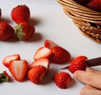 Cut strawberries into halves