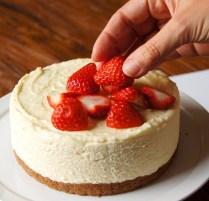 Arrange berries atop the cake