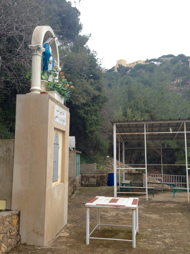 Outdoor altar and shrine for the Virgin Mary, hidden in the woods