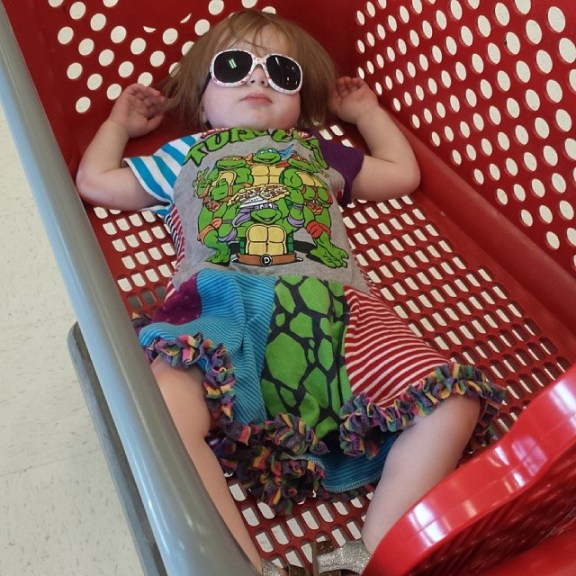 Avery sleeping in the target cart