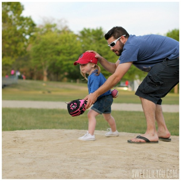 Daddy teaching Avery how to pitch a baseball