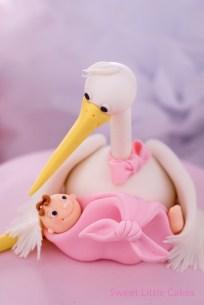 Cigüeña con bebé