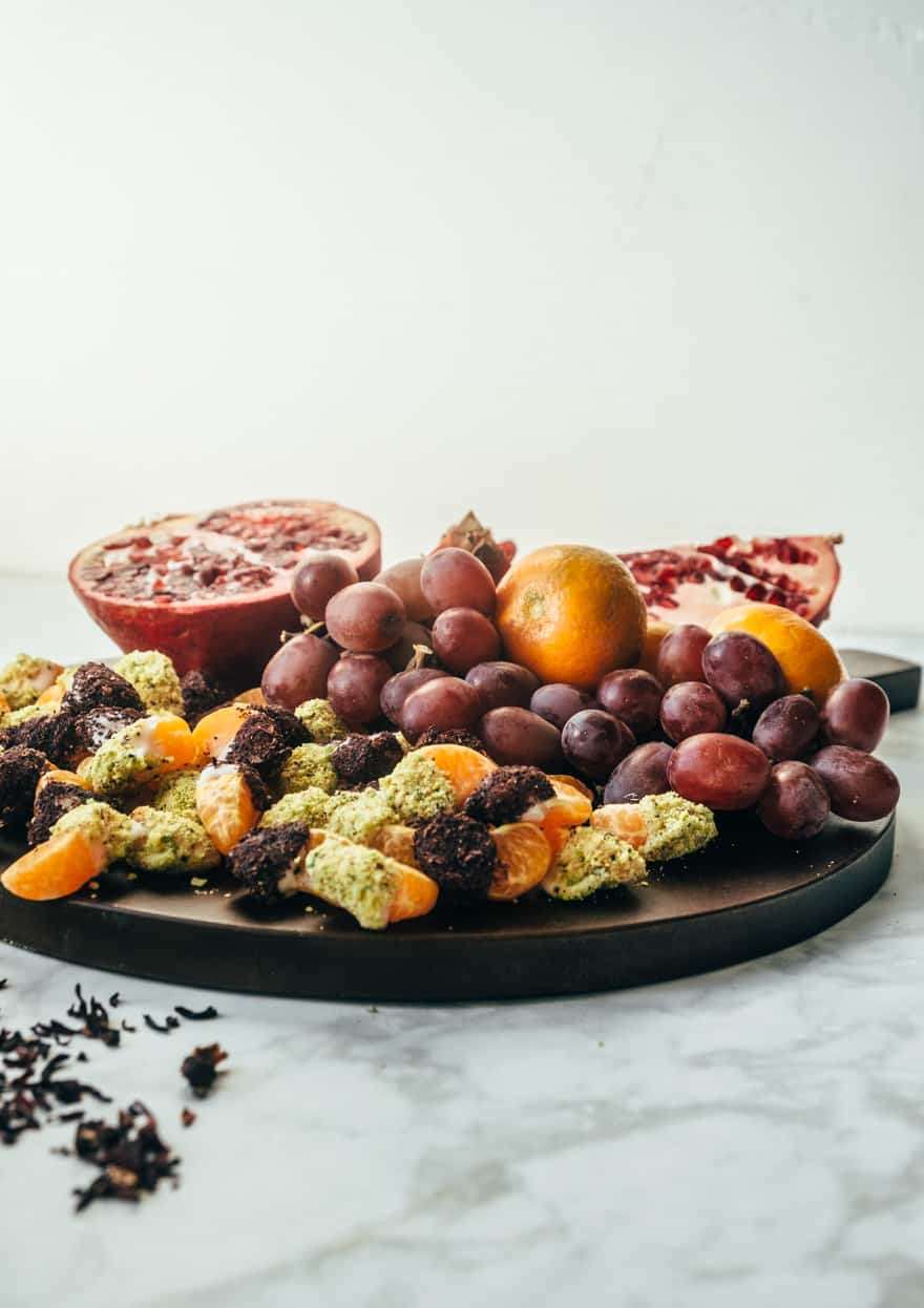 coconut butter dipped clementines with pistachios and hibiscus