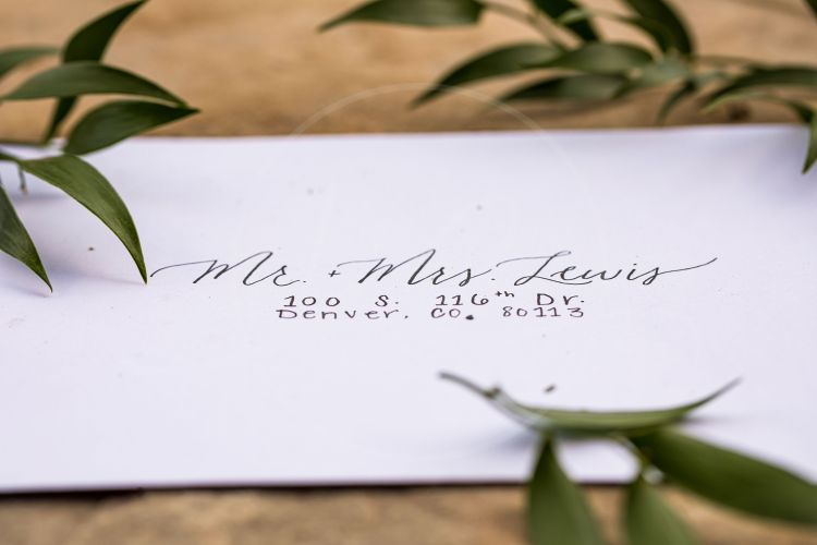 I played with lettering on the envelope and I absolutely love it! Hand written envelopes like this just give your invitations that extra touch- be sure to give your calligrapher extra time to get these done. They take a while to measure out and write.