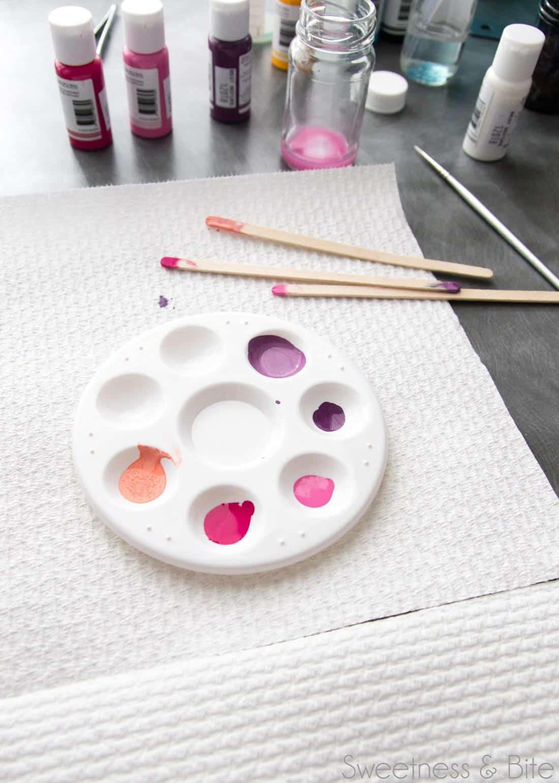 A paint palette with drops of edible art paint.