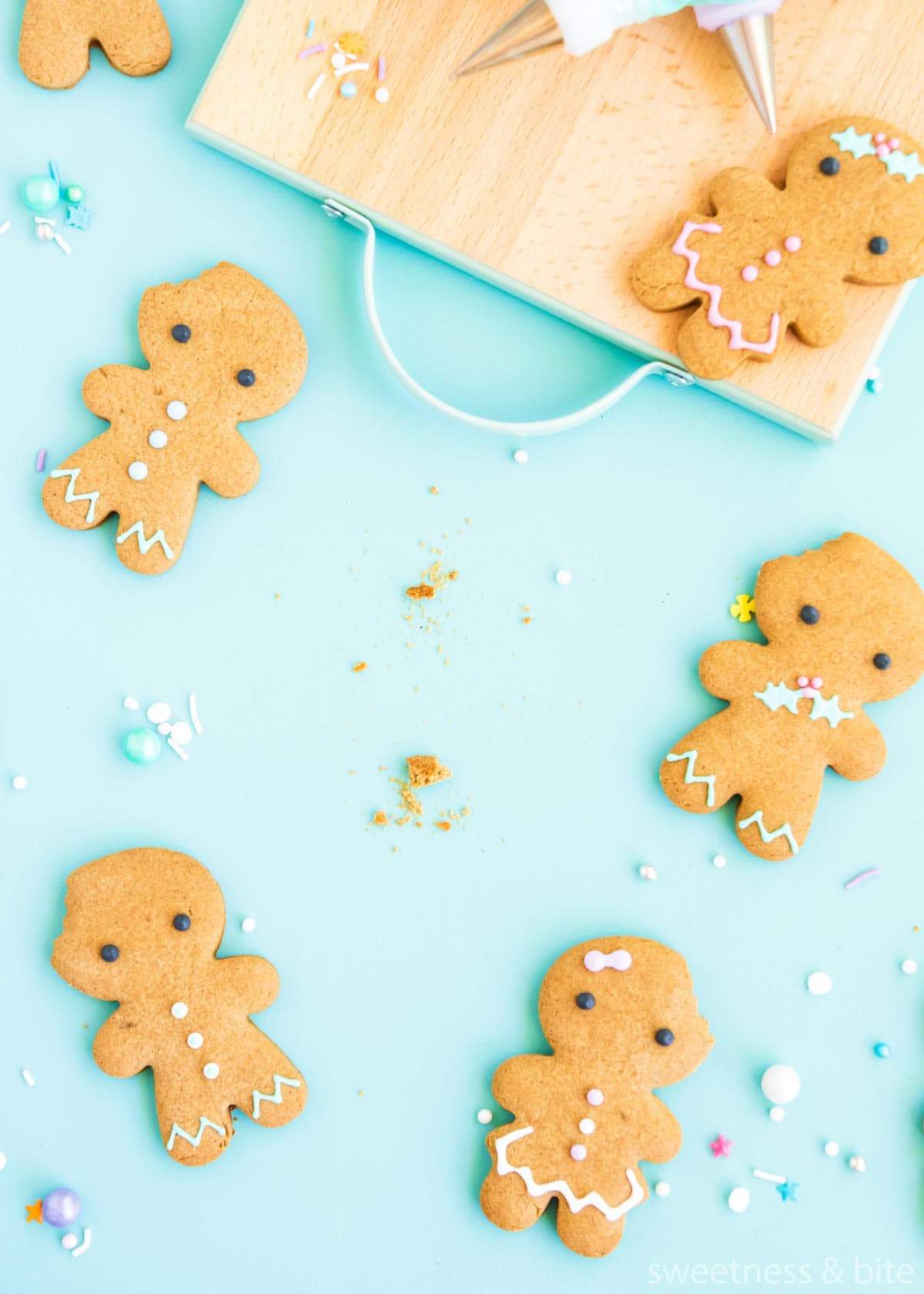 Gluten free gingerbread cookies with one missing and crumbs in its place.