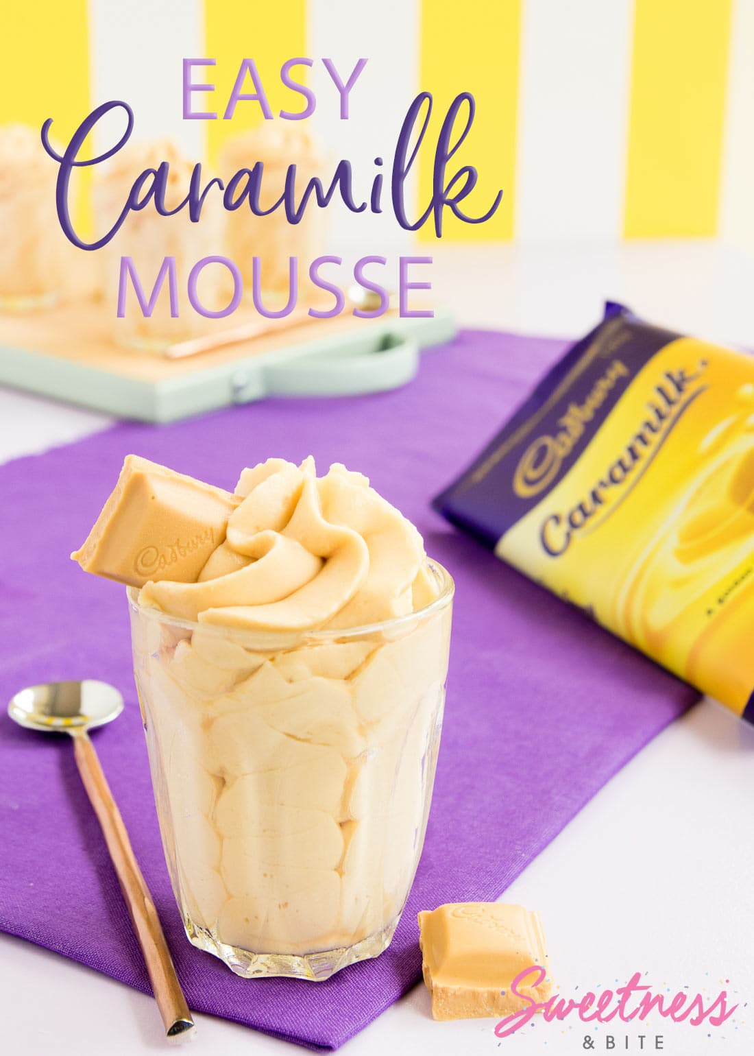 Caramilk Mousse piped in a swirl into a small glass, with a block of Caramilk chocolate in the background. Text overlay reads: Easy Caramilk Mousse.