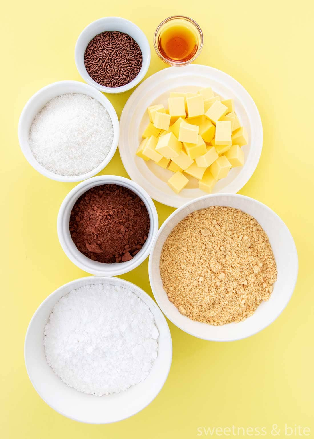 Chocolate coconut truffle ingredients - crushed cookies, icing sugar, butter, cocoa, coconut, vanilla and sprinkles