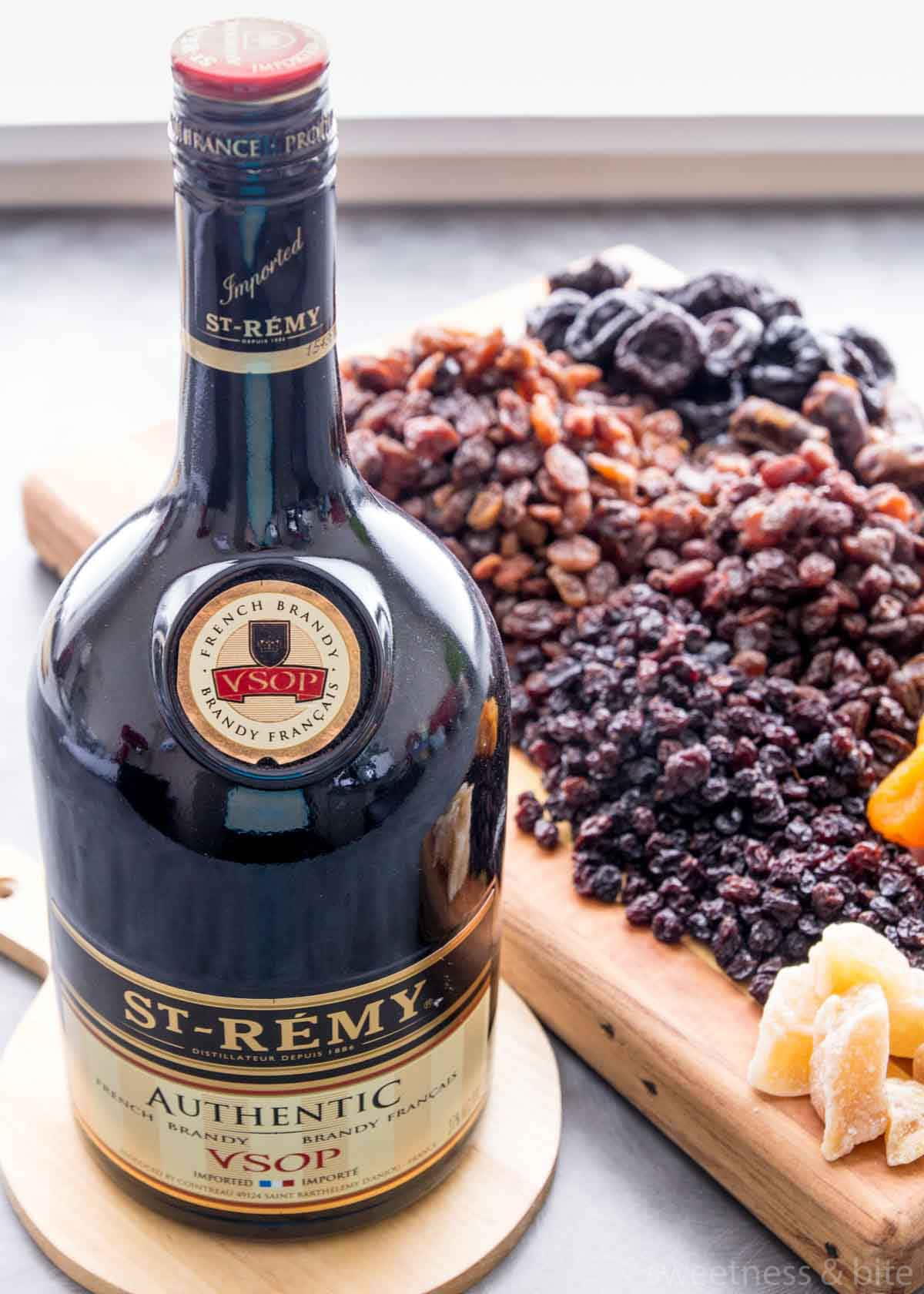 A bottle of St Remy brandy with dried fruits in the background.