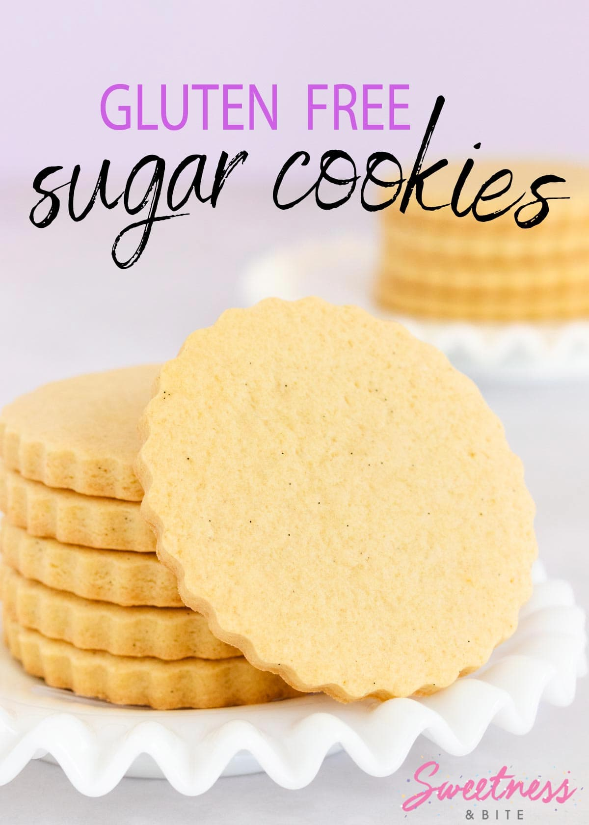 A stack of gluten free sugar cookies on a white plate with a ruffled edge.