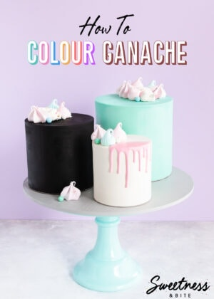 Three ganache covered cakes, black, white and teal, on a cake stand with text overlay reading:
