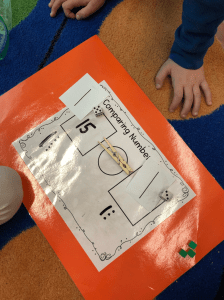 teaching comparing numbers using place value