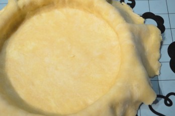 Smoothen the dough to cling to the pie pan