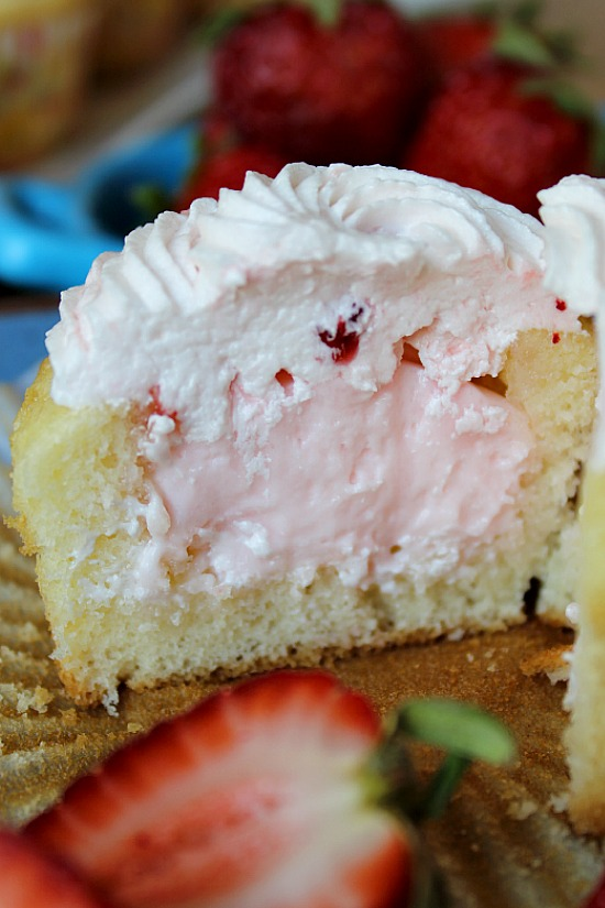 Half of an Easy Strawberry Cupcake showing pudding filled center.