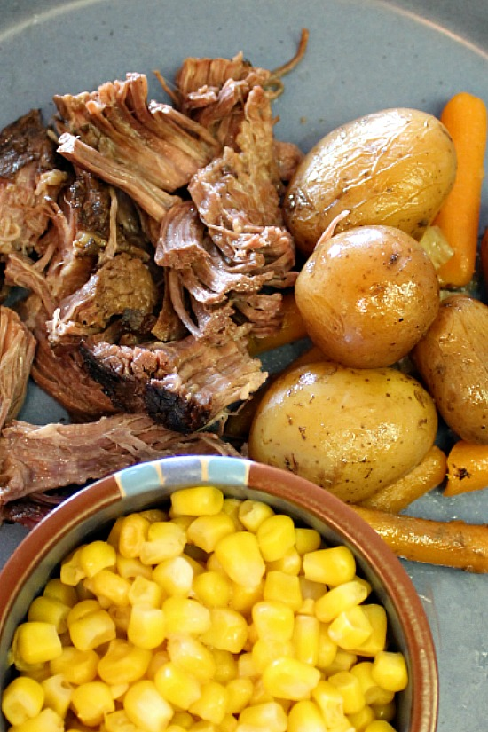 Chuck roast, little taters, and a side of corn.