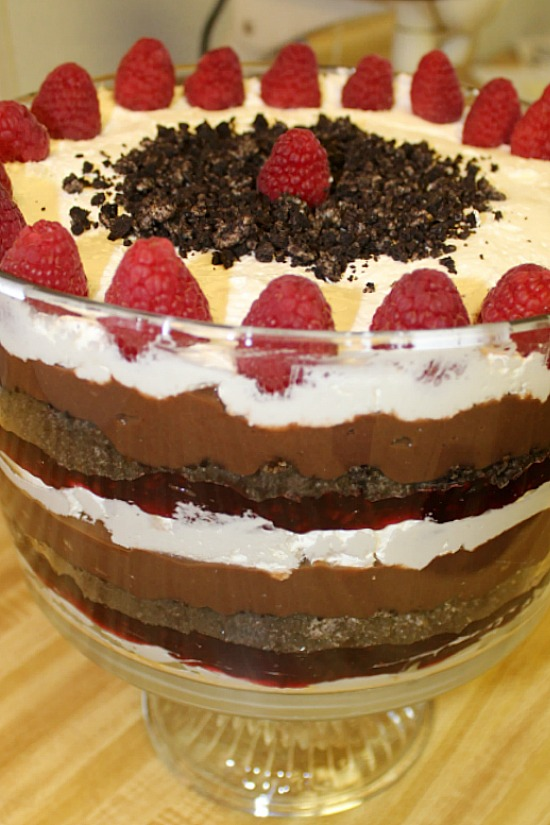 A decorated trifle of raspberry, chocolate, and cream cheese.