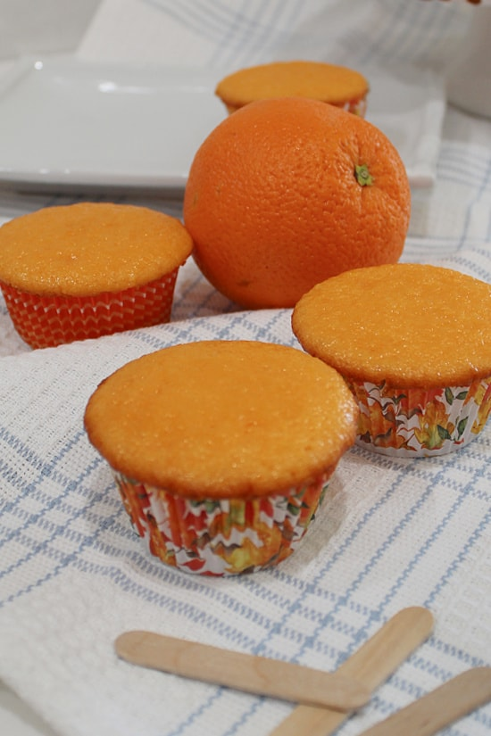 Unfrosted orange cupcakes.