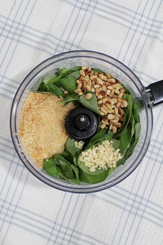 Parmesan cheese, roasted pine nuts, minced garlic over sweet basil leaves.