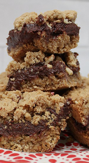 Mounded treats with thick chocolate layer, nuts, and rustic crumble topping.