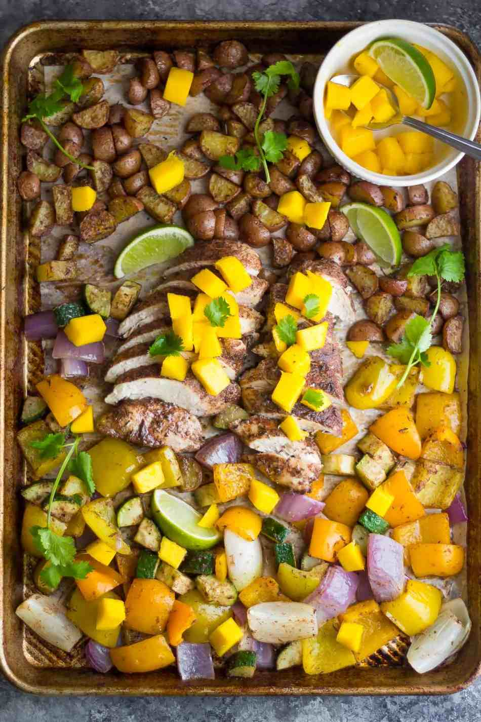 This Jamaican Chicken Sheet Pan Dinner is topped with fresh mango, cooks on one pan, and is ready in 30 minutes!
