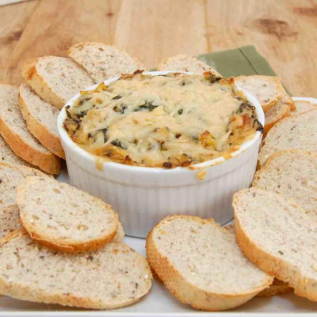 bowl of hot spinach artichoke dip