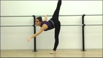 A penchée [pahn-SHAY] at the barre, which is a leaning arabesque