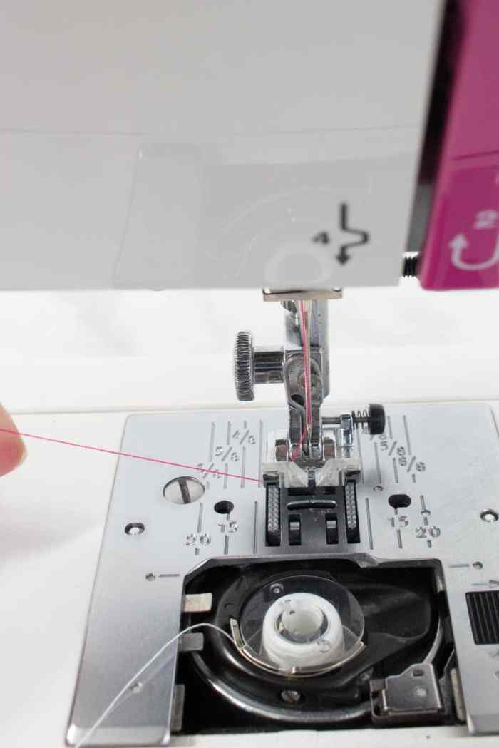 Sewing machine threading guide