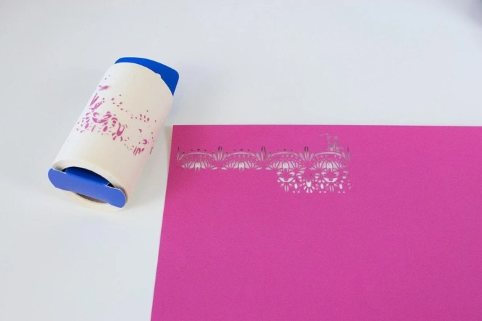 Use a lint Roller to remove small pieces of card stock