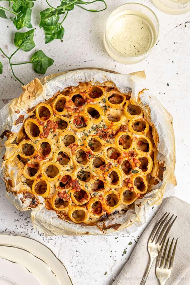 vegan pasta pie with lentil ragu white sauce