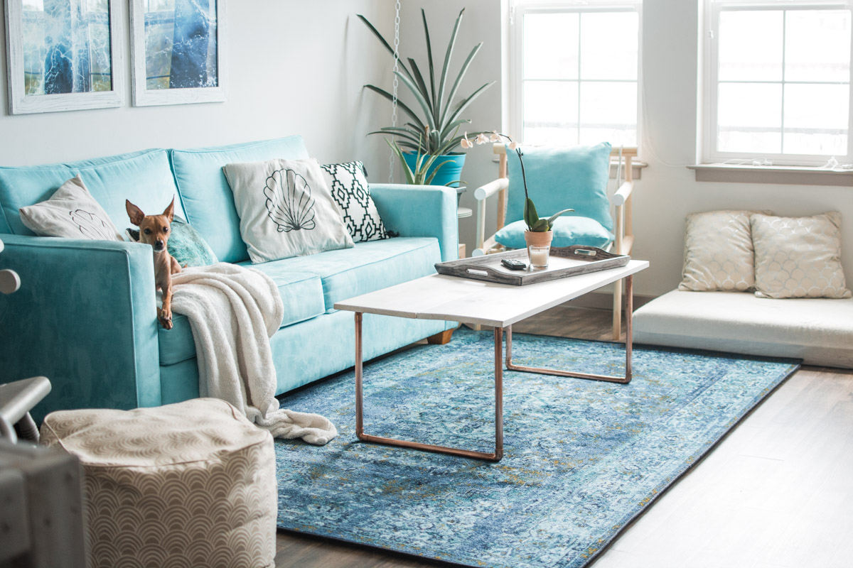 Boho Tropical Living Room with blue couch - sweet teal