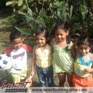 Adventures in paradise, small children with ball while on vacation in sweet T&T for Sweet TnT Magazine, Culturama Publishing Company, for news in Trinidad, in Port of Spain, Trinidad and Tobago, with positive how to photography.