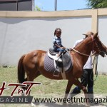 Boy on horse at special needs children Easter Bonnet parade at Queen's Park Cricket Club, color eggs, Sweet T&T, Sweet TnT, Trinidad and Tobago, Trini,
