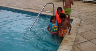 The Ali family in a pool at Crown Point, in sweet T&T for Sweet TnT Magazine, Culturama Publishing Company, for news in Trinidad, in Port of Spain, Trinidad and Tobago, with positive how to photography.