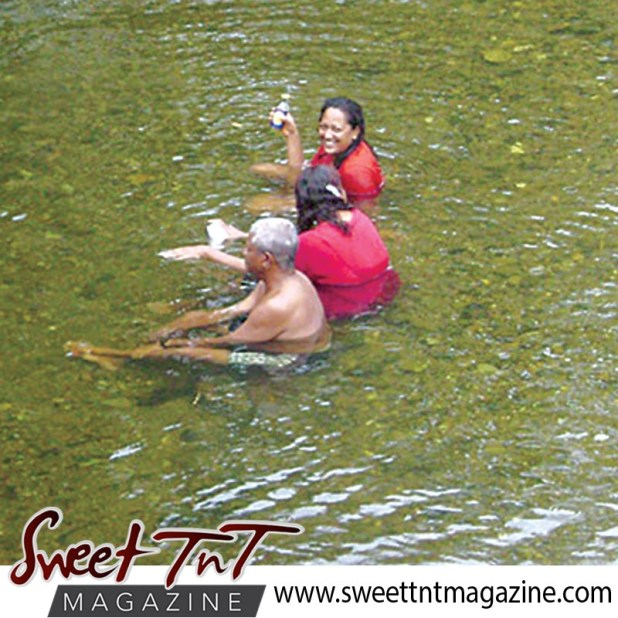 Bathers drinking in Shark River, Toco, Matelot in sweet T&T for Sweet TnT Magazine, Culturama Publishing Company, for news in Trinidad, in Port of Spain, Trinidad and Tobago, with positive how to photography.