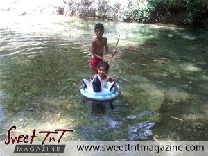Children playing in Caura River, in sweet T&T for Sweet TnT Magazine, Culturama Publishing Company, for news in Trinidad, in Port of Spain, Trinidad and Tobago, with positive how to photography.