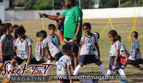 Coach points at students training, Football Factory, St Mary's college, CIC grounds, Terry Fenrick, sports in T&T, Sweet T&T, Sweet TnT, Trinidad and Tobago, Trini, vacation, travel